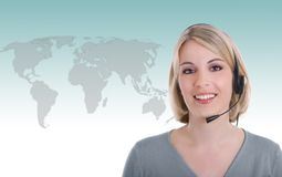 Internet operator. Young female operator against the World map background royalty free stock image