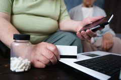 Senior couple doing online shopping using gadgets stock photos
