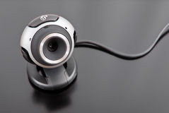 Internet PC Web Cam. On Black Surface stock images