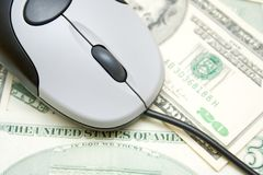 Internet purchase. Money spend over internet, computer mouse on the dollar bills Stock Image