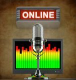 Internet radio concept. Online radio concept with retro microphone in the old studio with online sign and monitor