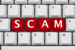 Internet Scams. A computer keyboard with red keys spelling scam, Internet Scams Royalty Free Stock Images