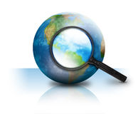 Internet Search Earth Globe on White. A magnifying glass is searching the earth and there on a white isolated background. Use it for an internet or travel Royalty Free Stock Images