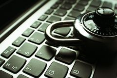 Internet Security With Black Number Dial Lock On Laptop Keyboard High Quality. Stock Photo Royalty Free Stock Photos