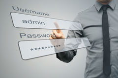 Internet security concept. Businessman with virtual login screen Royalty Free Stock Photography