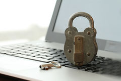 Internet security concept-old padlock and key on laptop computer Stock Images