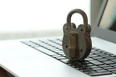 Internet security concept-old padlock and key Stock Images