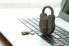 Internet security concept-old padlock and key Stock Photography