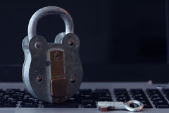 Internet security concept-old padlock and key Stock Photos