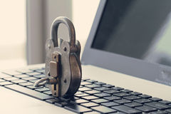 Internet security concept-old padlock and key Stock Image