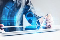 Internet security concept with woman working on media screen with stylus. Close up of female hands using tablet and lock icon on screen royalty free stock photos