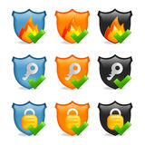 Internet security icon shield set. Set of 9 shield icons depicting firewall, key & lock, in blue orange and black variations Royalty Free Stock Photos