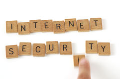 Internet Security Wood Letters. Close-up of wood letters spelling out internet security and a letter being taken away Royalty Free Stock Photography