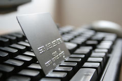 Internet shopping. A credit card on a computer keyboard Stock Photos