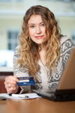 Internet Shopping. Young woman buys on the web Stock Photography