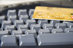 Internet shopping. Close-up of keyboard with Find and Save keys in focus and a credit card on top Stock Photography