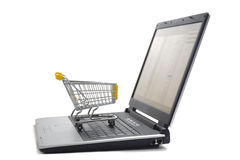 Internet shopping. Shopping basket on computer keyboard as symbol for internet shopping Royalty Free Stock Photos