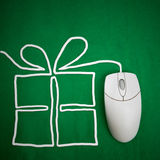 Internet Shopping. Online present shopping concept, mouse on green background with present Stock Photography