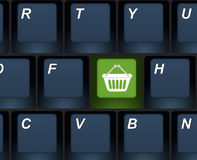 Internet shopping buy key on a computer keyboard. Closeup of a computer keyboard, e-commerce concept illustration Royalty Free Stock Photo