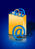 Internet shopping concept. Email symbol in a bag Royalty Free Stock Photography