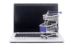 Internet Shopping Concept. Shopping Cart on Modern Laptop Computer Isolated on White Background Stock Photos