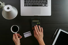 Internet shopping concept.Top view of hands working with calcula Stock Photo