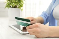 Internet shopping concept. Woman paying online order with card Royalty Free Stock Photography