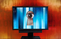 Internet spying. Eye spying from monitor keyhole Stock Images