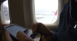 Internet surfing on cell phone before flight stock video