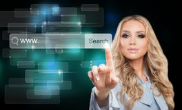 Young Businesswoman Touching Virtual Web Browser. Internet Surfing Concept with Pointing Female Hand. Businesswoman Touching Virtual Web Browser Address Bar or royalty free stock image