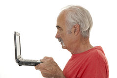 Internet surfing senior Stock Photos
