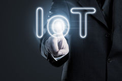 Internet of things activation. Man touching IoT (internet of things) text on display Royalty Free Stock Images