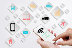 Internet of Things concept (IoT) with man hands holding smart ph. One in order to connect various devices, smart machines and object icon, Digital Marketing Royalty Free Stock Photo