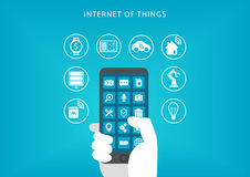 Internet of things concept. Vector illustration of hand holding smart phone Stock Photography