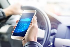 Internet of things IOT mobile app in smart phone. Internet of things IOT mobile app in smart phone for modern car. Hand holding smartphone with futuristic ADAS Stock Photo