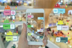 Internet of things marketing concepts,smart augmented reality,customer hold the mobile phone to see  the shop type that search by. Ai application and predict stock photography