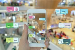 Internet of things marketing concepts,smart augmented reality,customer hold the mobile phone to see  the shop type that search by. Ai application including stock photos