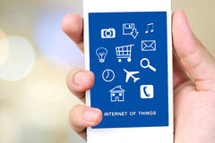 The internet of things on smart phone screen, technology and dig. The internet of things on smart phone screen over blur bokeh light background, technology and Royalty Free Stock Photography