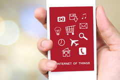 The internet of things on smart phone screen, technology and dig. The internet of things on smart phone screen over blur bokeh light background, technology and Stock Photos