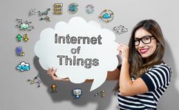 Internet of Things text with woman holding a speech bubble stock illustration