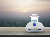 Internet transportation service concept. Car flat icon with wireless computer mouse over modern city tower at sunset, vintage style, Internet transportation Stock Photo