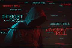 Internet troll concept with faceless hooded male person stock photography