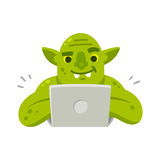 Internet troll with laptop. Internet troll with computer. Funny cartoon vector illustration of green goblin typing on laptop Stock Photos