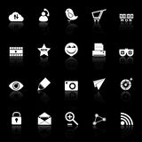 Internet useful icons with reflect on black background Royalty Free Stock Image