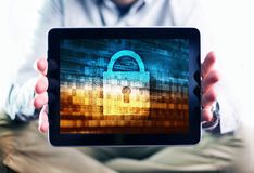 Internet User Protection. Concept Photo. Men Showing Tablet Computer Mobile Device with Internet Security Concept Illustration on the Display. Safety in the Stock Image