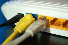 Internet UTP cable plugs in wifi router. Close up. Internet concept. Selective focus. Technology concept image Stock Photo