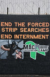 Internment Mural on the Falls Road. A mural opposing forced searches at the Maghabbey Prison in Antrim, Northern Ireland. The mural is located on the Falls Road Stock Photo