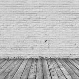Interno del fondo: pavimento di legno e del muro di mattoni fotografie stock