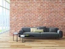 Interno del sottotetto con il muro di mattoni ed il tavolino da salotto Immagini Stock