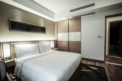 Interno della camera da letto o della camera di albergo Fotografia Stock